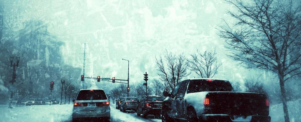 Cars, during the winter, waiting at traffic lights