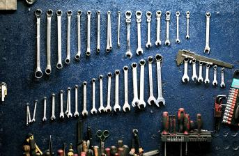 mechanics tools lined up on a table