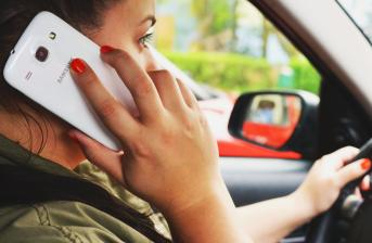woman talking on phone whilst driving